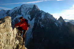 Rock-climber. Climber in front of the west face of Mont Blanc, Italy Royalty Free Stock Image