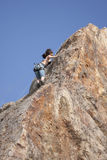 Rock Climber. Malibu, CA, USA - May 14, 2011:  An unidentified woman climbs up a sheer cliff on May 14, 2011 at Point Dume in Malibu, CA, USA.  The Point Dume Stock Photography