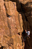Rock Climber-2. Woman who is equally competant stock image