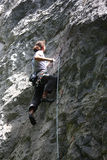 Rock Climber. Young active male rock climbing Stock Images