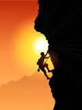 Rock Climber. Silhouette of a rock climber against a sunset sky Royalty Free Stock Photography