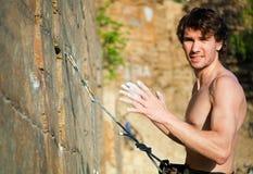 Rock climber. Portrair of young rock climber on the rock royalty free stock photos