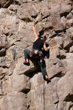 Rock climber. On side of steep rocky mountain Stock Photography