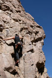 Rock climber in Arizona. Rock climber on side of rock formation in Arizona royalty free stock image