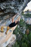 Rock climber ascending a challenging cliff. Extreme sport climbing. Freedom, risk, challenge, success. Sport and active l stock photo