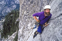 Rock climber ascending Half Dome. Royalty Free Stock Images