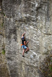 Rock climber battling his way up Stock Photography