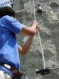 Rock climber and belayer Stock Photos