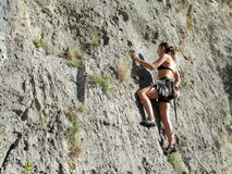 Rock climber on the big wall Stock Images