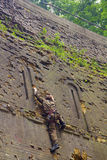 Rock climber on brick wall Royalty Free Stock Photography
