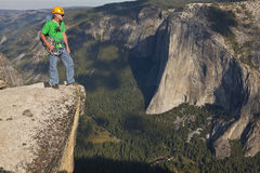 Rock climber celebrates on the summit. Stock Image