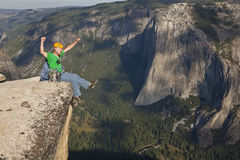 Rock climber celebrates on the summit. Stock Images