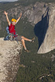 Rock climber celebrates on the summit. Stock Photos