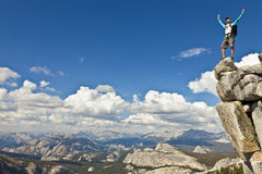 Rock climber celebrates on the summit. Royalty Free Stock Photo