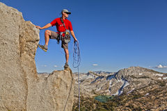 Rock climber celebrates on the summit. Stock Photography