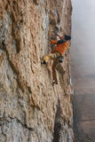 Rock climber on a challenging ascent. Extreme climbing. Stock Image
