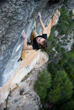 Rock climber on a challenging ascent. Extreme climbing. Unique sports. Stock Photos