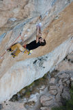 Rock climber on a challenging ascent. Extreme climbing. Unique sports. Stock Photo