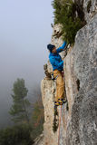 Rock climber on a challenging ascent. Extreme climbing. Stock Images