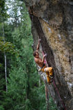 Rock climber on a challenging ascent. Extreme climbing. Unique sports. Outdoor. Royalty Free Stock Photos