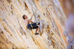 Rock climber on challenging route on cliff Stock Photo