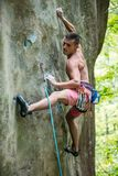 Rock climber on challenging route Stock Photography