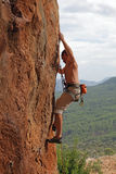 Rock climber on cliff Stock Photo