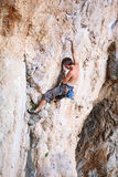 Rock climber on a cliff Stock Photo