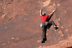 Rock climber on cliff Stock Photos