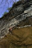 Rock climber on cliff face in Virginia