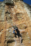Rock climber on the cliff Stock Images