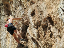 Rock climber on the cliff Stock Photography