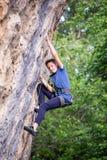 Rock Climbing Training. Rock climber climbing an overhanging cliff royalty free stock images