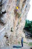Rock Climbing Training. Rock climber climbing an overhanging cliff royalty free stock photo