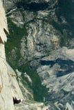 Rock climber climbing a rock Stock Photography