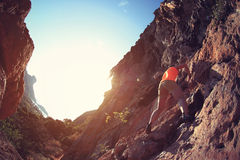 Rock climber climbing at seaside mountain cliff Royalty Free Stock Photos