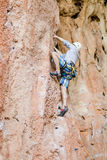 Rock climber climbing up Royalty Free Stock Image