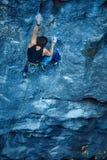 Rock climber climbing up a cliff Royalty Free Stock Photos