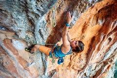 Rock climber climbing up a cliff Stock Images