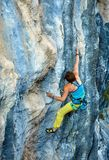 Rock climber climbing up a cliff Royalty Free Stock Photography