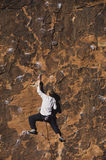 Rock Climber Climbing Up A Cliff Royalty Free Stock Images