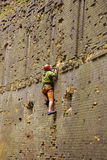 Rock climber climbing up Royalty Free Stock Photo