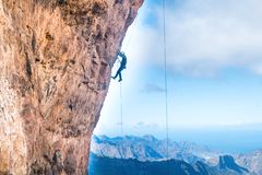 Free Rock Climber Climbing Up Overhanging Cliff Royalty Free Stock Images - 135637659