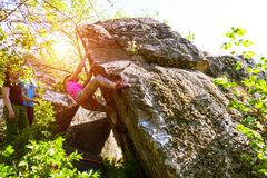 Athletes are bouldering outdoors. Royalty Free Stock Photo