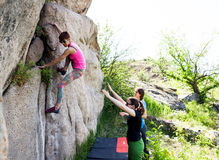 Athletes are bouldering outdoors. Stock Photography