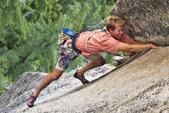 Rock climber clinging to a cliff. Royalty Free Stock Photography