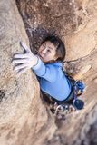 Rock climber clinging to a cliff. Stock Photography