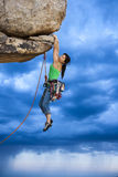 Rock climber clinging to a cliff. Royalty Free Stock Photo