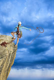 Rock climber clinging to a cliff. royalty free stock photos