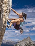 Rock climber clinging to a cliff. Royalty Free Stock Image